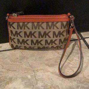 Michael Kors orange wristlet/small bag